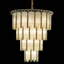 This Waterfall Chandelier Is Layered With Clear Glass and Chimes In Either Gold or Silver, Offering A Soft, Even Glow. Crowned With A Ring of Crystal, Chimes Is the Perfect Embodiment of Modern Luxury.