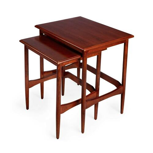 These splendid Mid-Century modern-inspired nesting tables provide function and beauty in any space. Taking up the space of just one table, the second nested table is readily available whenever needed. Use for entertaining, game nights and more. Crafted from mahogany wood solids and veneer, the tables boast attractive tapered legs, shaped stretchers and a contemporary light mahogany finish.