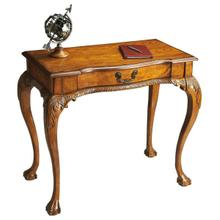 See Details - Selected solid woods, wood products and choice oak veneers. Oak veneer top. Finished on all sides. Hand carved details. Drawer with antique brass finished hardware.