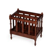 Organize your magazines and periodicals with this elegant magazine rack. Featuring a warm Antique Cherry finish and a center panel conveniently dividing the space inside into two compartments, it has spindled corner posts and slatted side panels. Crafted
