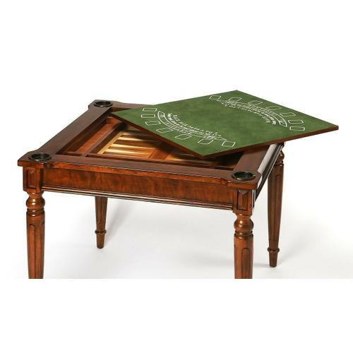 Butler Specialty Company - Play a variety of games on this stylish table that is veneered with antique cherry finish. The top inset has a game board for chess and checkers. Flip the inset over and it converts to a green felt-lined blackjack table. Remove the insert altogether and the well(beneath the inset) is a back-gammon game board. Four glass holders on each corner. Chess and other game pieces are not included.
