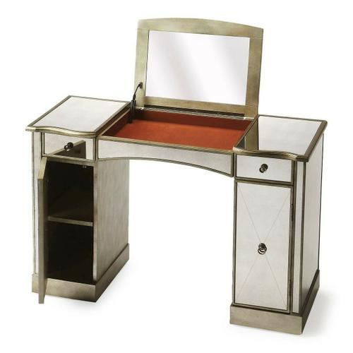 This glitzy vanity with antiqued mirrored top, front and sides and complementary pewter trim, makes a strong style statement while providing abundant storage. It offers adjustable shelves behind two doors, two drawers, plus a storage compartment beneath the hinged center lid. Hardware is finished in sophisticated antique brass. Crafted from hardwood solids and wood products.