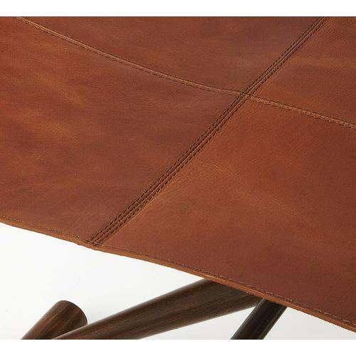 Butler Specialty Company - Leather meets wood for a smiple folding seat. Great alone or in multiples; its carefully stitched warm brown leather seat is supported by soild Meranti and Shorea wood base. This stool folds for easy portability and storage.
