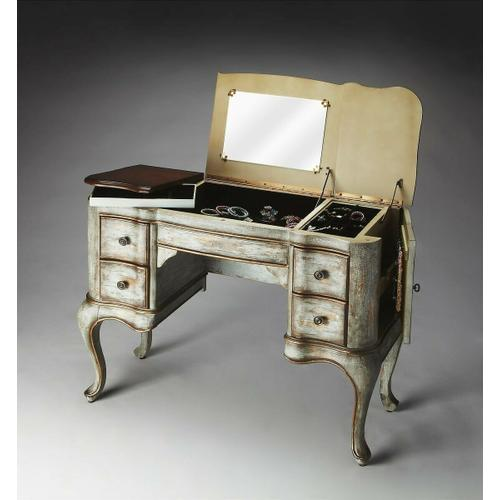 This vanity is every bit as practical as it is beautiful. Crafted from poplar hardwood solids and wood products, it features a Rustic Blue hand painted finish with a heavily distressed cherry veneer top. Side doors open for jewelry storage. Top sides open to reveal felt lined sections. Top center with mirror opens to reveal felt lined compartment. Four felt lined drawers with antique brass finished hardware.