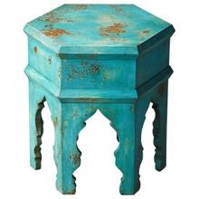 This hexagonal Moroccan-inspired bunching table is crafted from mango wood solids. It features a heavily distressed blue finish. Its versatility and scale allow it to be used alone or bunched in multiples to create a larger table surface or even used as a