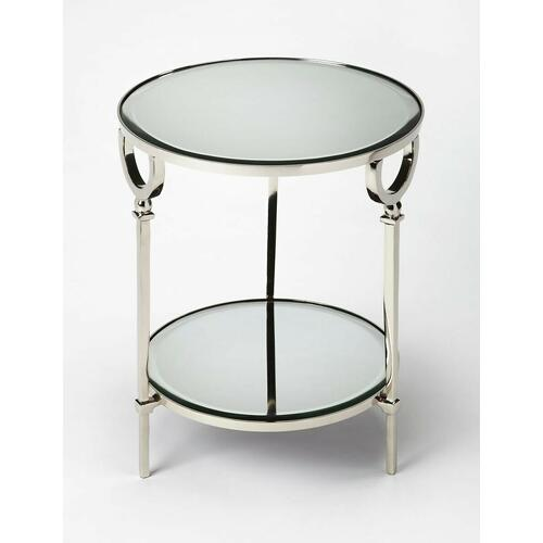 Add this stunning round end table in the living room, bedroom, or office for a glamorous modern design statement. Featuring a polished aluminum base, its tapered legs rise to support a beveled mirrored glass top and bottom display shelf.