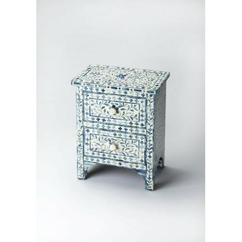 Butler Specialty Company - The elegance of the Indian subcontinent and thousands of years of artistisanry provide us with this contemporary two-drawer accent chest. Painstakingly handcrafted from wood solids and wood products, delicate bone inlay veneers, each pattern is hand-formed with unique design and unique delicacy, against a blue background. Complementary drawer pulls and carved leg braces provide character. This chest fits in any small space and provides an artistic showcase singly or in pairs.