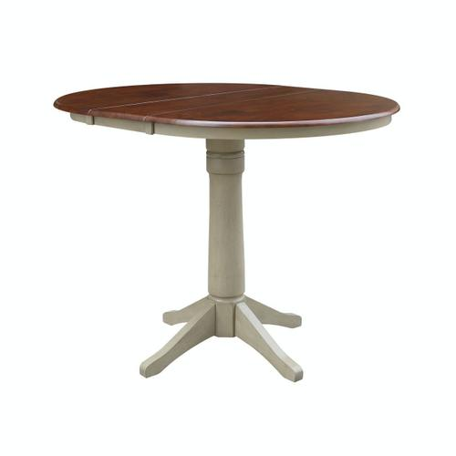 John Thomas Furniture - Round Extension Table in espresso/Almond