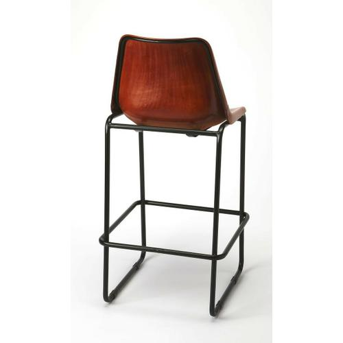 Create a warm ensemble in your eat-in kitchen by pulling several of these stools up to the kitchen island or bar. This modern rustic barstool has rich color in its leather seat. A decortive strip of rivets adorn where the seat meets the back. This seat i