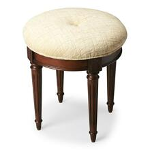 This splendid vanity stool adds formal elegance to any powder or dressing room. Handcrafted from hardwood solids and cherry veneers, it features impeccably carved and tapered legs, ballerina feet, classic Plantation Cherry finish and a comfortable seat upholstered in cotton hobnail fabric.