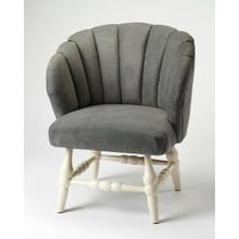 The perfect design statement, this accent chair provides a unique curved back, accented by channeled stitching, while round turned legs in a painted white finish complete the look. The attractive upholstery is soft, velvet-like, sturdy polyester. Its gray color adds a touch of glamour to this farmhouse silhouette.