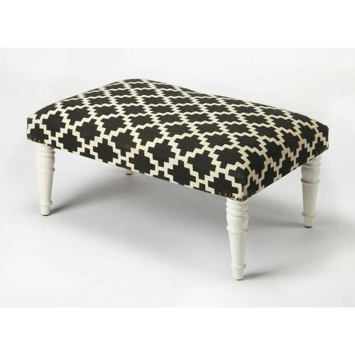 Use this elegantly stylish ottoman as a seat or as a footstool in your living or entertainment area. With its substantial surface area, it can also be used as a coffee table. Its Mango wood solids legs support a stylish, upholstered urethane foam and cotton top, with nail head trim.