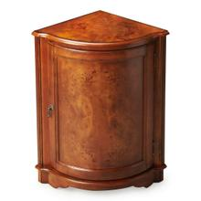 Perfect for dressing up a neglected corner, this cabinet features olive ash burl veneers along its top and door panel. The door, adorned with a pull in an antique brass finish, opens to reveal a shelf within its always-welcome storage space. Crafted from select wood solids and wood products.