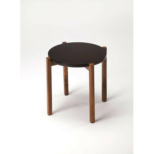 This contemporary side table will add interesting style to any space. The straight acacia wood legs with rich woodgrain support a round black top in an exciting contrast of color and texture. The modern shape of this table is fetching.