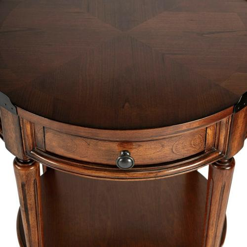Butler Specialty Company - Adorned with four-way matched cherry veneers, the top of this stately accent table boasts an antique brass finished gallery that matches the drawer knob. Elegantly crafted from selected solid woods and wood products.