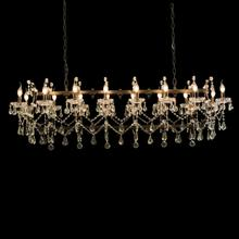A Traditional Crystal Chandelier With an Industrial Twist. Featuring Classic Candles, Looping Clear Crystal Webs and Black Iron, This Versatile Piece Pairs With Luxury and Casual Alike.