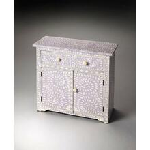 This lavender console chest offers a unique touch to any room. Developed from centuries old artistic traditions, the pastel background showcases the opalescence of hand-carved bone inlay. The two doors and single drawer are complimented with bone pulls making the perfect hiding place for table linens and serving trays, or bedside for all your favorite keepsakes.