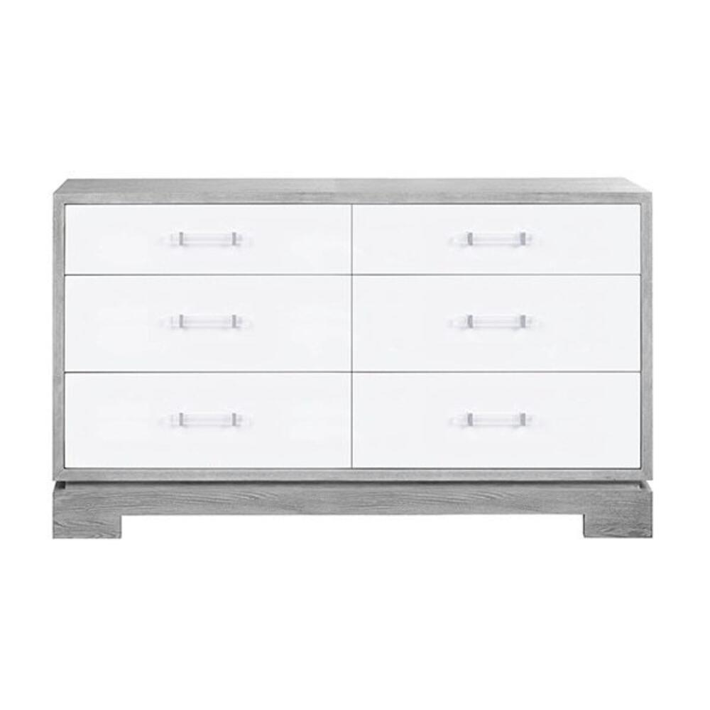 Dressed In Matte White Lacquer and Grey Cerused Oak, This Mid-century Modern Chest Makes A Bold Yet Classic Statement With Its Clean, Architectural Style and Contrasting Finish. as A Welcome Touch, the Streamlined, Acrylic Cylinder Pulls Evoke A High Style Appeal. Six Drawers Offer Generous Storage, Making This Piece as Utilitarian as It Is Handsome.