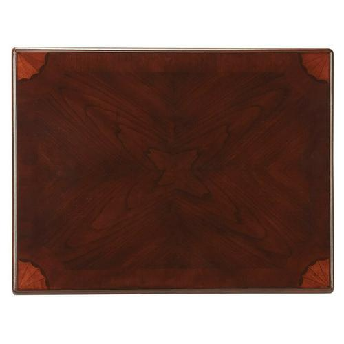 Selected solid woods, wood products and choice veneers. Features a matched cherry veneer top with maple and walnut veneer linen-fold inlaid designs at each corner. Drawer with antique brass finished hardware.