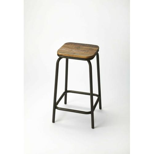 This mixed material bar stool will stylishly enhance your space. Featuring an industrial chic aesthetic, it is hand crafted from mango wood solids, iron.