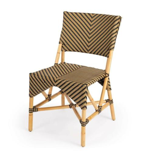 Evoking images of sidewalk tables in the Cote d'Azur, chairs like this will give your kitchen or patio the casual sophistication of a Mediterranean coastal bistro. Expertly crafted from thick bent rattan for superb durability, it features weather resistant woven plastic in a black and beige striped pattern. This chair is lightweight for easy mobility with comfort to make the space it's in a frequent gathering place.