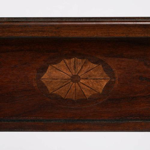 Selected solid woods, wood products and choice veneers. Cherry veneer top. Linen-fold inlay design of maple and walnut veneers on front apron. Lower display shelf.