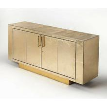 See Details - This modern buffet is magnificent in every conceivable way. Its sleek lines are adorned in finely tailored leather atop a brass platform base. Proving that all that glitters is not gold, its two doors with brass finished handle bar pulls open to reveal a luxurious interior fully lined in polysuede with meranti wood trim with two adjustable shelves in each of the two side storage compartments, one adjustable shelf in the center storage compartment and a tray drawer with a gold leather front and ball bearing glides for smooth operation. Masterfully crafted from meranti wood solids and wood products, it has a brass door lock that operates using a brass key with a matching gold leather tassel.