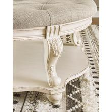 Realyn Ottoman Cocktail Table White/Brown