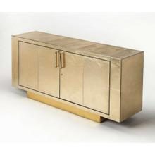 Product Image - This modern buffet is magnificent in every conceivable way. Its sleek lines are adorned in finely tailored leather atop a brass platform base. Proving that all that glitters is not gold, its two doors with brass finished handle bar pulls open to reveal a luxurious interior fully lined in polysuede with meranti wood trim with two adjustable shelves in each of the two side storage compartments, one adjustable shelf in the center storage compartment and a tray drawer with a gold leather front and ball bearing glides for smooth operation. Masterfully crafted from meranti wood solids and wood products, it has a brass door lock that operates using a brass key with a matching gold leather tassel.