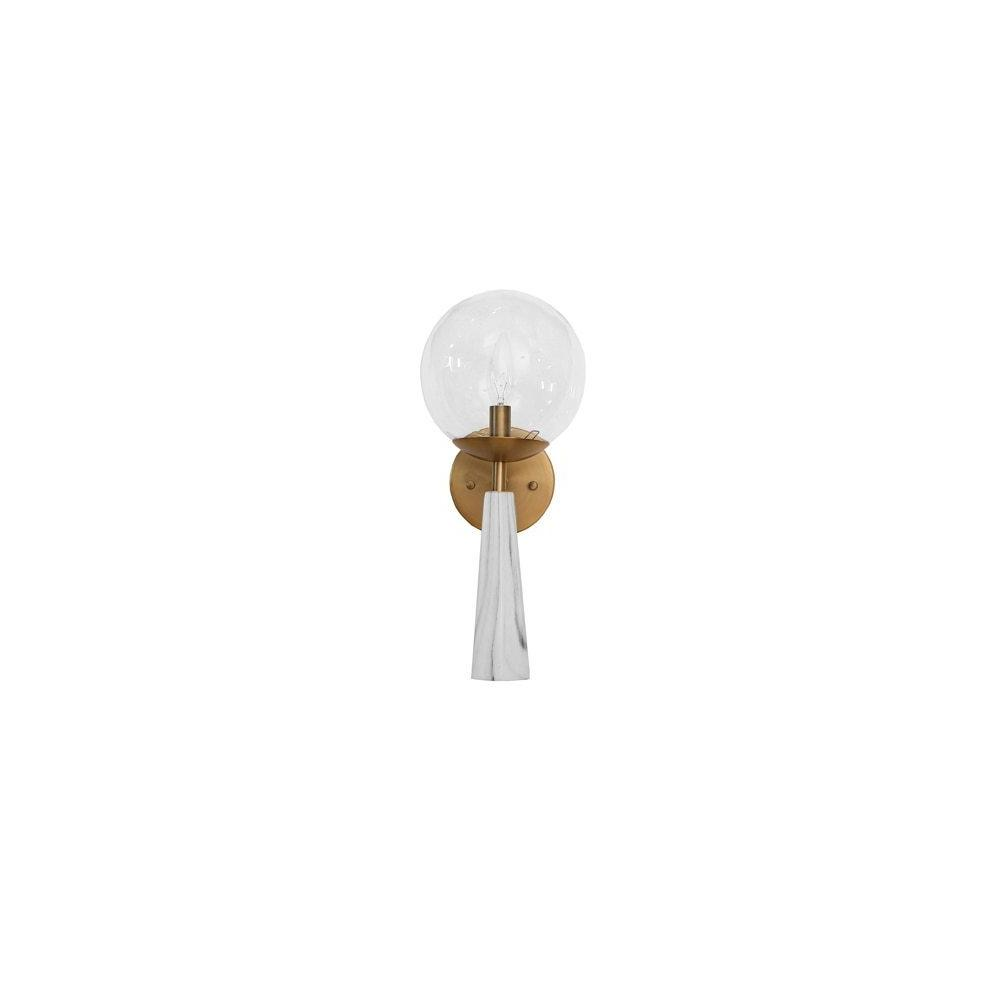 The Materials Palette In Our Shelly Sconce Is A Study In Polish and Sophistication. Antique Brass Detailing Unites A Faux Marble Base With A Singular Glass Globe In This On-trend Fixture.