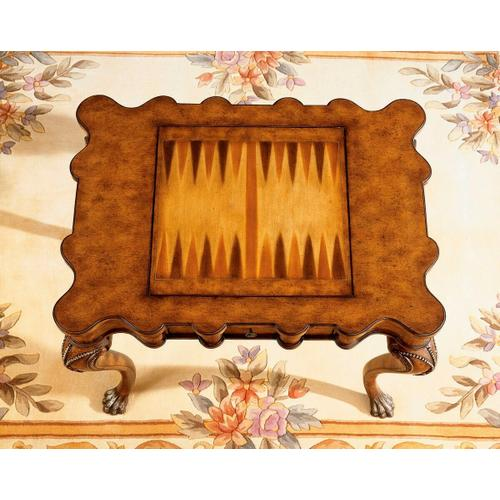 Selected solids and choice veneers. Hand carved details. Reversible game board with chess on one side and backgammon on reverse. Two drawers with antique brass finished hardware. Chess and other game pieces shown are not included.