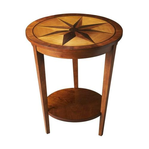 Butler Specialty Company - This dazzling transitional accent table features an engaging starburst inlay and reverse-tapered legs conjoined by a round lower display shelf. Crafted from select hardwood solids and wood products, it features an inset maple veneer top with a walnut and maple veneer starburst inlay pattern bordered by walnut and cherry veneers in a warm Honey finish.