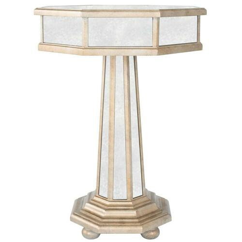 This Grecian-inspired mirrored accent table will reflect the beauty of your home while adding a natural glow. Expertly crafted from poplar hardwood solids and wood products, its antique mirrored glass panels and fly-specked pewter finish make this silhoue