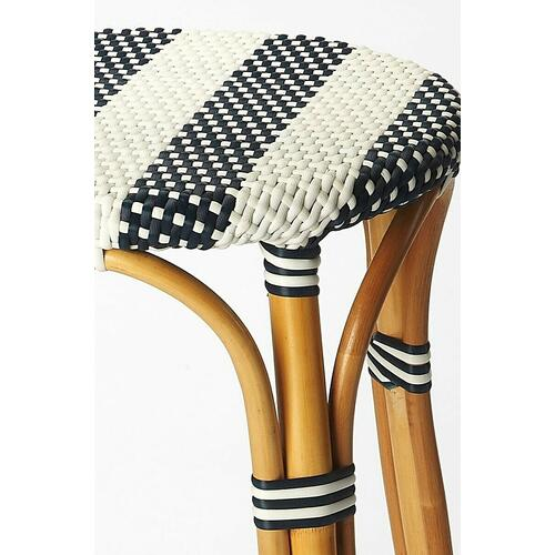 Evoking images of sidewalk tables in the Cote d'Azur, barstools like this will give your kitchen or patio the casual sophistication of a Mediterranean coastal bistro. Expertly crafted from thick bent rattan for superb durability, it features weather resistant woven plastic in a blue and white striped pattern. This backless barstool is lightweight for easy mobility with comfort to make the space it's in a frequent gathering place.