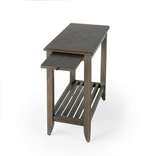 This chairside table is the ideal blend of function and design, complete with a pull-out shelf for a beverage and a comely slatted bottom shelf. Crafted from select hardwood solids and wood products, it features a matched cherry veneer top in a heavily di