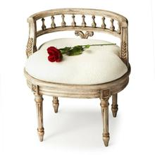This elegant hand painted vanity seat adds formal elegance to any powder or dressing room. Hand crafted from poplar hardwood solids and wood products, it features a carved solid wood back and legs. The generously-sized, upholstered seat cushion is covered in an ivory cotton hobnail fabric.
