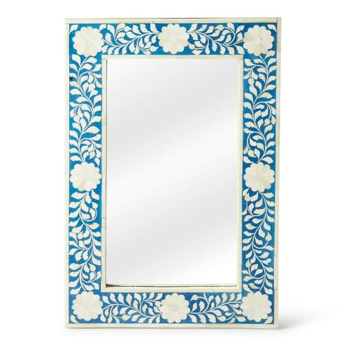 This magnificent Wall Mirror features sophisticated artistry and consummante craftsmansip. The botanic patterns covering the piece are created from white bone inlays cut and individually applied in a sea of blue by the hands of a skillful artisan. No two mirrors are ever exactly alike, ensuring this piece will hang as a bonafide orginal.