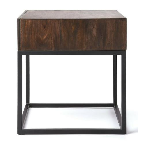 The minimalistic industrial styling of this square end table is an ideal addition in any modern space. Supported by a black finished iron base, its drawer box is constructed from mango wood solids and wood products in a distressed dark brown finish. With clean lines and convenient drawer, the table also makes a great nightstand.