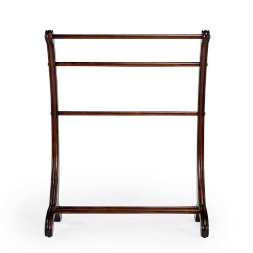 This charming transitional blanket stand is a practical addition in any living room, bedroom, or bathroom. Made from rubberwood and poplar hardwood solids, it boasts arched side supports with hand-carved appointments in a vibrant Plantation Cherry finish.