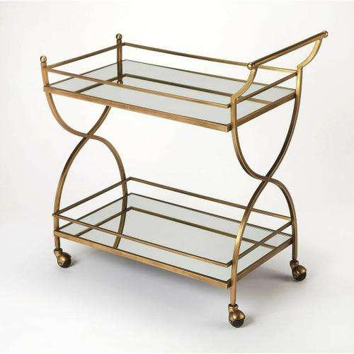 This glamorous modern bart cart is a must-have for anyone that enjoys entertaining. Forged from stainless steel and aluminum, it boasts a mesmerizing antique gold finish with two mirrored glass shelves. Guests will be sure to follow as four large casters ensure easy mobility from one room to the next.