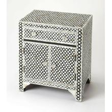 This alluring accent chest is certain to be the focal point in a living room, bedroom or entryway. Expertly crafted from merranti wood solids and wood products, it features gorgeous mother of pearl inlays in a Moroccan quatrefoil pattern against a black resin background. For function, there is a drawer and lower storage cabinet with clear acrylic pulls.