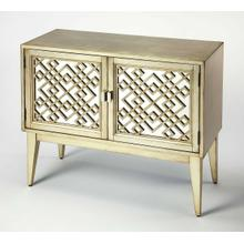 Glam meets mid-century modern style with this eye-catching console cabinet. Crafted of solid and manufactured wood in a hand applied Antique Silver Leaf finish, this charming design features geometric latticework doors complete with aged gold-toned hardwa