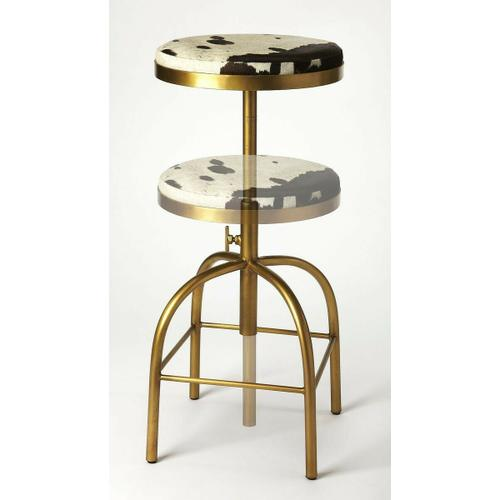 Butler Specialty Company - Perfect pulled up to your open-concept kitchen island, or paired with a rustic home bar, this stylish swivel bar stool lends a touch of rustic appeal to any ensemble. Crafted of Iron in a gold finish, the four-legged frame features a hand adjustment and a built-in, sqaure footrest. Sporting a warm brownish black and white finish, the backless Hair on Hide leather seat features a mechanism to keep you in the flow of conversation, while a threaded column shaft adjusts the seat height for a customized fit.