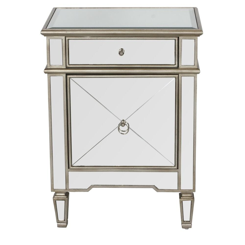 A Consummate Designer Favorite, This Hollywood Regency Lamp Table Shimmers With Pristine Cross Hatch Mirror, Beveled Mirror Top, and Polished Nickel Hardware. dimensional Wood Borders Are Finished In Brilliant Metallic Silver. Ample Drawer and Cabinet Storage Provide Wonderful Utility for This Stunning Jewelry Piece.