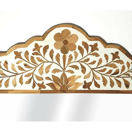 This magnificent wall mirror features sophisticated artistry and consummate craftsmanship. The botanic patterns covering the piece are created from Teak Wood inlays cut and individually applied in a sea of white magestic hues by the hands of a skillful artisan. No two mirrors are ever exactly alike, ensuring this piece will hang as a bonafide original.