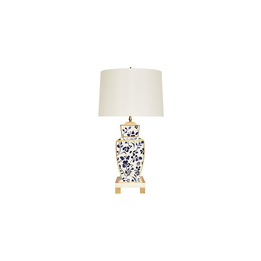 The Extraordinary Bianca Table Lamp Is A Modern Take On A Timeless Classic, Featuring A Distinctive Urn-shaped Base With Hand-painted Tole In an Elegant Navy Floral Vine Pattern. Accented With Gleaming Gold Edges and Floating Atop A Four Leg Base, Bianca Is A Stunning Addition To Brighten Any Room.