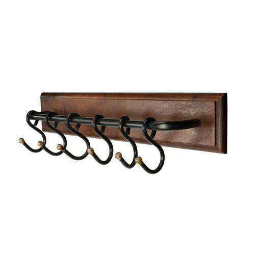 Crafted of mango wood and iron. This sturdy wall rack offers an elegant solution for hanging jackets, hats, and scarves in an entry or hall. Features six iron hooks for an industrial/rustic look and is finished in a rich dark finish.