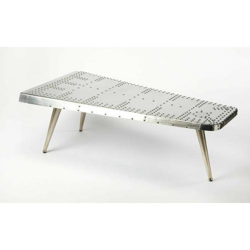 This table is riveting, soaring with the flair of an airplane wing and guaranteed to help a room take flight. Resplendent in shimmering aluminum, the table sits atop three matching legs that taper down for a very smooth landing indeed.