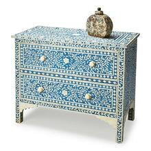This dazzling two-drawer chest speaks of centuries-old tradition and craftsmanship. Painstakingly handcrafted with beautiful bone inlay veneers on native wood solids and wood products, it features hand cut and formed vine patterned elegance, with complementary drawer pulls, against a blue colored background. Variations in bone inlay create unique character in each hand-created masterpiece.