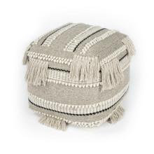 Create your perfect space with the addition of this tasseled Pouf! The comfy, bohemian vibe lends casual glamour to any space. This round, grey toned Pouf is adorned with the perfect amount of tassels. Perfect for use in a living room, entryway, bedroo
